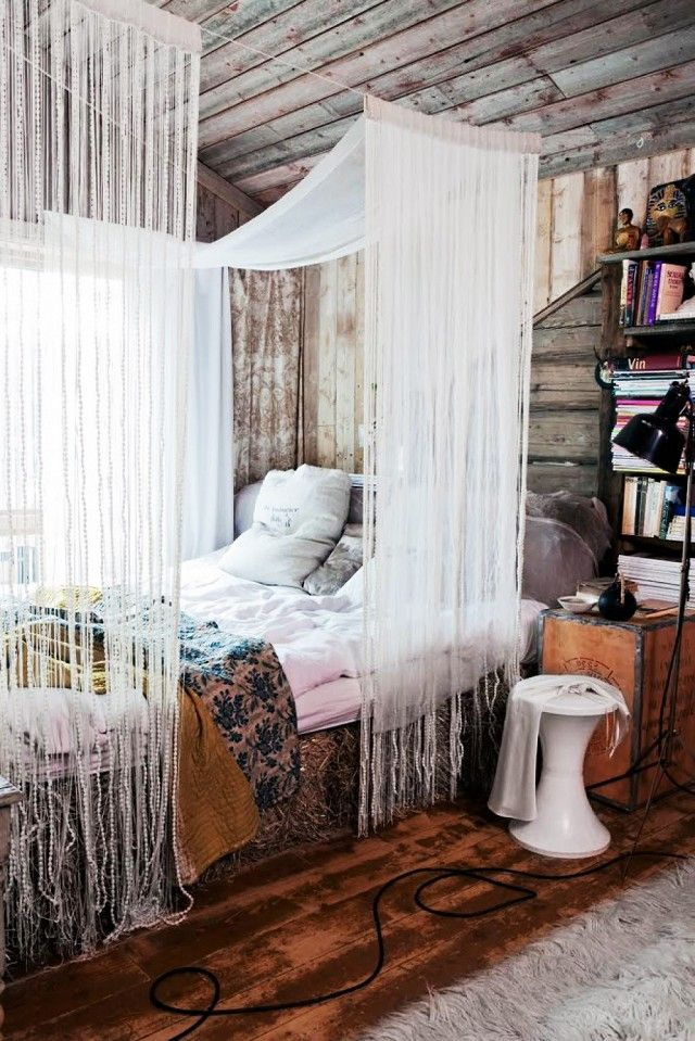 FRINGED whispy fabric hung from CLOTHESLINE makes cozy canopy.