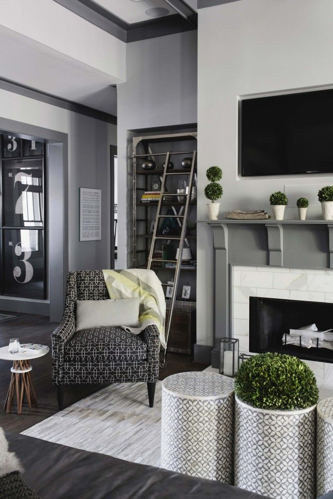 gray tones achieve modern yet warm look in this living room b