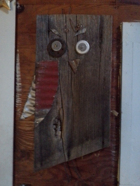 """Junk on wood """"Owl""""  Made on century old reclaimed Oak, with reclaimed rusty roofing tin, knots, bolts and more...all salvaged materials."""