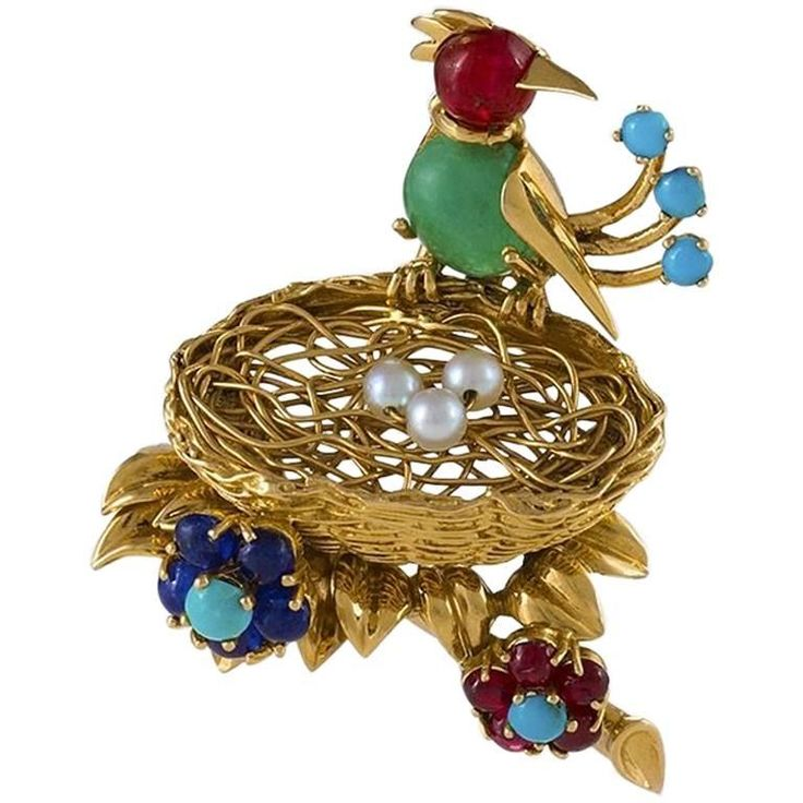 "CARTIER Paris -Late 1950s - 'Bird in a Nest' Brooch. The bird has a cabochon Emerald body with an approximate weight of 1.00 carat, 6 cabochon Rubies with an approximate total weight of  .65 carat, 5 cabochon Sapphires with an approximate total weight of .35 carat, 5 Turquoise beads, and 3 cultured Pearls. The whimsical brooch depicts a bird nesting on 3 Pearl eggs in a woven gold wire nest.  Signed, ""Cartier"" ""750"" ""38545"". $17,500"
