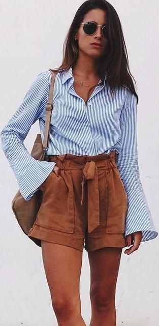 striped shirt. tan shorts.