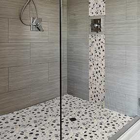 Mixing sizes and textures in the bathroom creates a stunning look! Gray & White Bathroom Tile - re-invented.