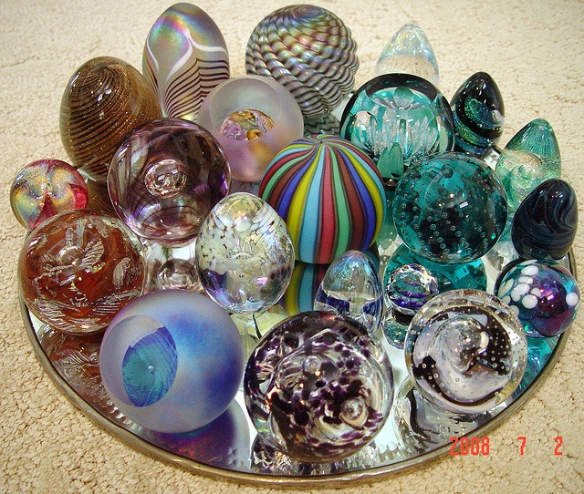 Paperweights can be collected and displayed in a relatively small area, creating great color and interest. Love this idea