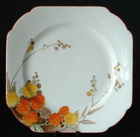 This is an art deco Shelley China, England 6.25 inch square bone china salad, dessert or side plate in the Acacia pattern #12255 in the Regent or Vincent shape with orange and yellow blossoms and an o