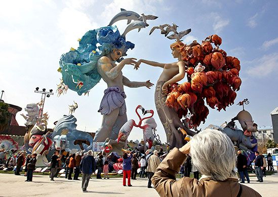 Valencians prepare to honour their patron saint San José (St Joseph) in a festival that culminates in giant papier-mache, cardboard and wooden sculptures being burned to the ground on 19 March.