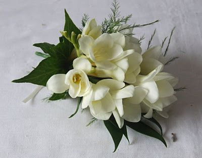 Mother of the bride corsage...White freesia's for Grammie Jo xo