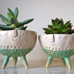 Tripod Bowl Planters, Set of 2 - My personal favorites are these handmade plant pots with happy faces by London-based ceramicist Stella Bagg...