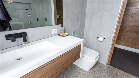 Photo Album Website Bathroom colour pallet polished concrete floor with slight aggregate concrete render look on walls white bench top mirror on wall and timber ca u