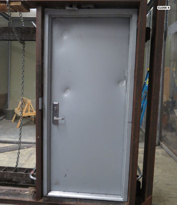 Tornado door having a tornado shelter above ground is an for Safe rooms