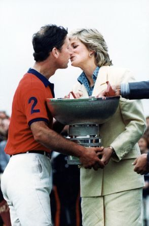 The Prince of Wales gets a kiss from his wife Diana, Princess of Wales, as well as the Silver Jubilee Cup, after the Prince of Wales' team had defeated Peru by seven goal to five at the International Polo meeting at the Guards Polo Grounds in Great Windsor Park, Windsor, England, on July 26, 1987.