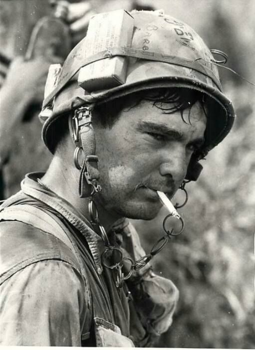 SP4 Carl Line, of Clinton, Illinois calmly smokes a cigarette during a break in an operation near the town of Thu Duc, ten miles north of Saigon. 27 February 1969 UPI Kent Potter