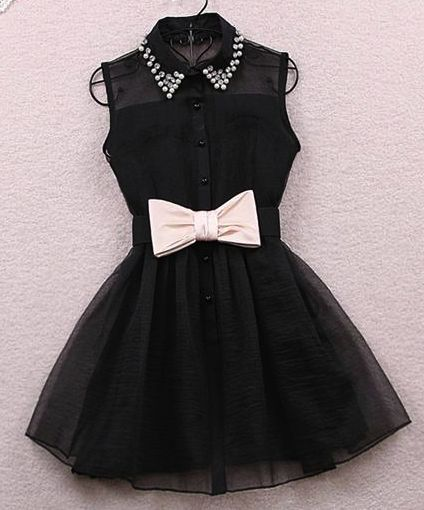 Black dress with a cute white now like a girls dress tuxedo.