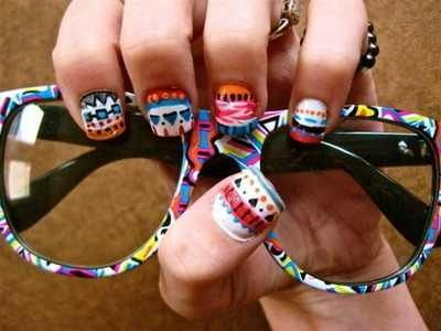 Aztec tribal nails with matching hipster glasses