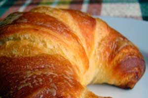 Easy croissant recipe for Christmas Breakfast/Brunch, serve with fresh butter that the kids can make in baby food jars, nutella, or fresh jam!