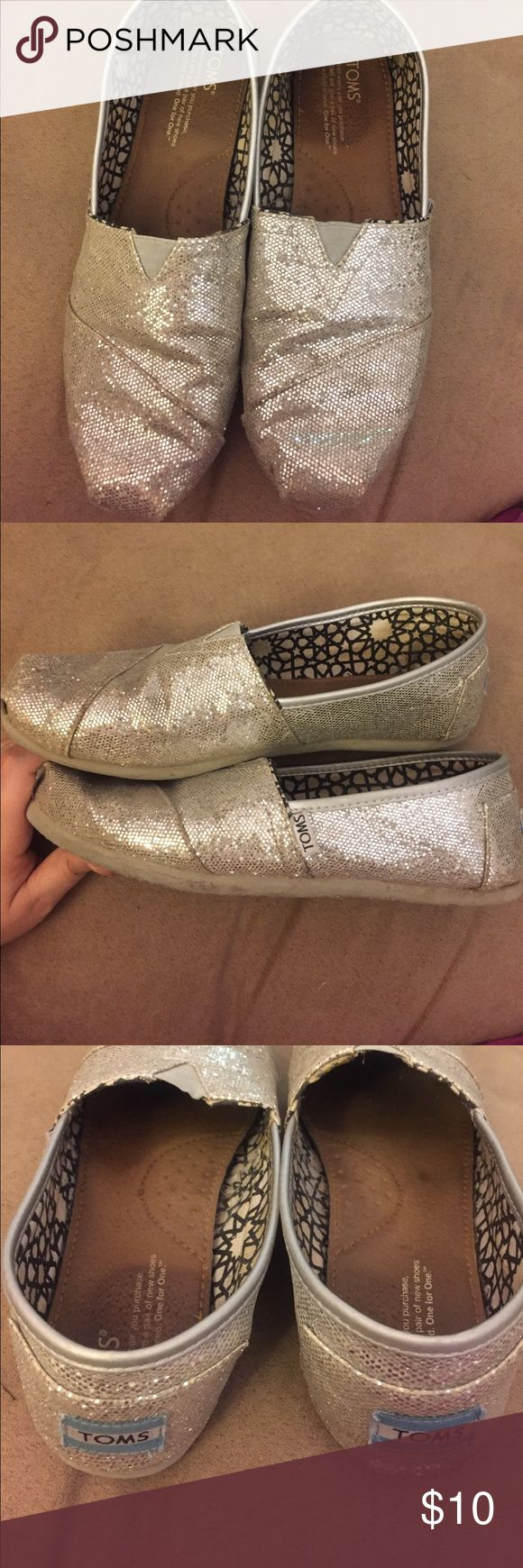 Toms glitter flats Toms glitter slide on flats in good condition. Still super sparkly. Photos show wear on sole. TOMS Shoes Flats & Loafers