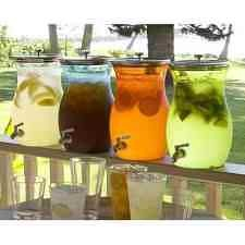 Rustic wedding idea - glass drink dispensers