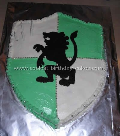 I was wondering how to do a medieval lion/dragon on the shield cake.  Never thought of melted chocolate as an option. This was a cool trick.