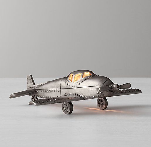 Cast aluminum vintage airplane toy nightlight with distressed finish for aviation themed nursery
