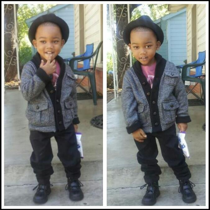 Brandon Jr.  Hat (Spencers), Sweater and Shirt (Gap), Pants (H), Boots (Polo)