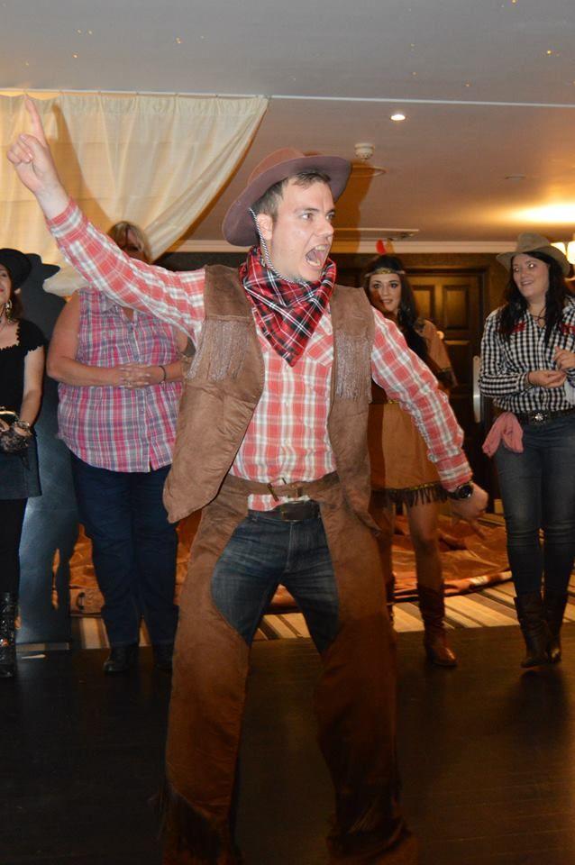 Wild West Themed Company Ball enjoying the Line Dancing!