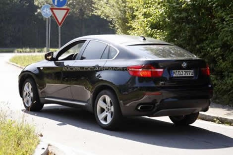 2012 BMW X6-2. Slab-sided, fat-arsed monstrosity and totally impractical