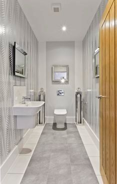 Stylish downstairs loo. Modern contemporary. Silver and white metallic wallpaper. Designed by  Jakara Interior Design