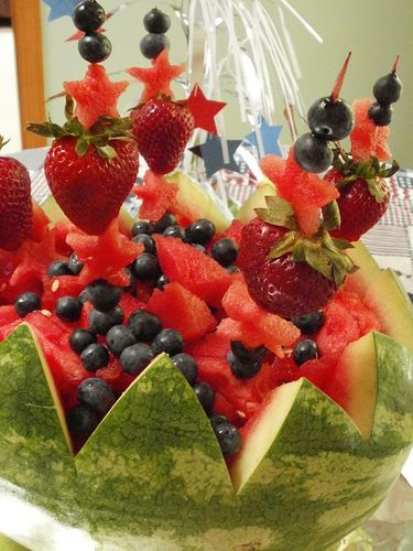 Watermelon centerpiece - with berry kabobs.  Great for summer holidays!