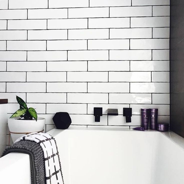 This is looking more and more appealing as the end of the week gets closer! The dark grout with our Argila White subway tiles are a great way to highlight their worn-look edges.