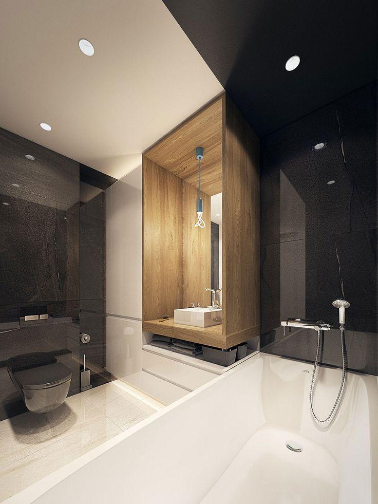 Bagno moderno e audace con piastrelle nere lucide.