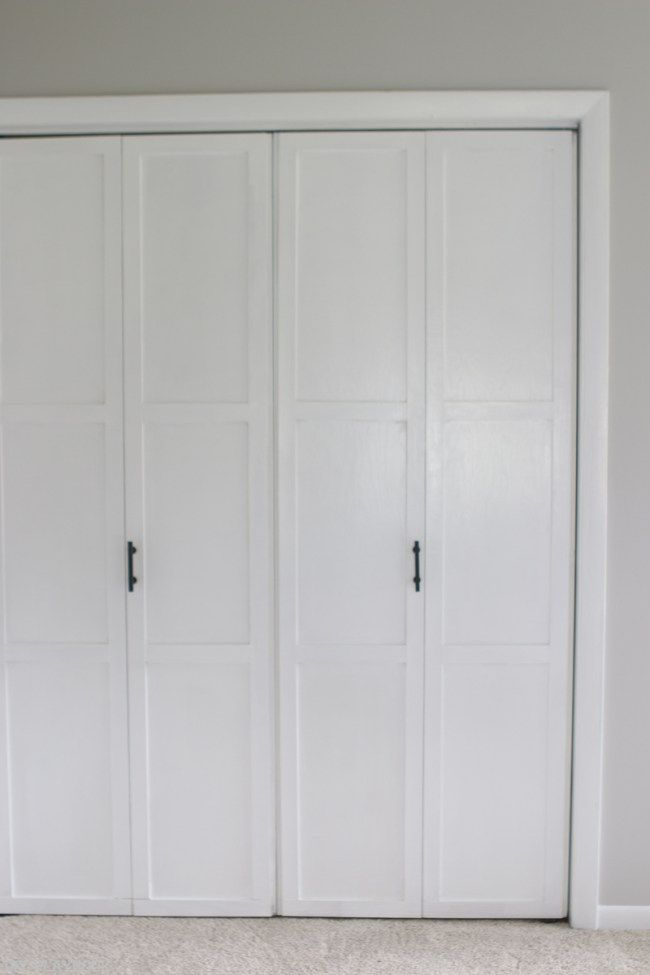 Spruce up old bi-fold doors with some molding and fresh paint. Love these white closet doors now! Such an easy DIY idea for any space.