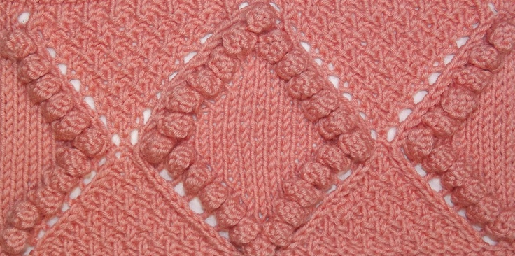 Moss Stitch Diamond with Bobbles is found in the Bobble & Slip Stitches category.