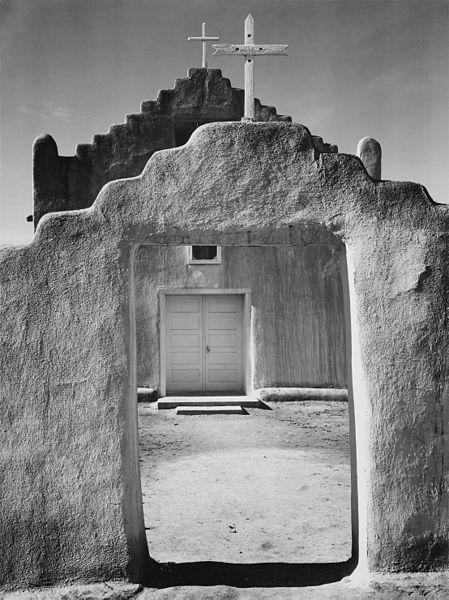 "Front view of entrance, ""Church, Taos Pueblo National Historic Landmark, New Mexico, 1942,"" Ansel Adams, public domain via Wikimedia Commons."