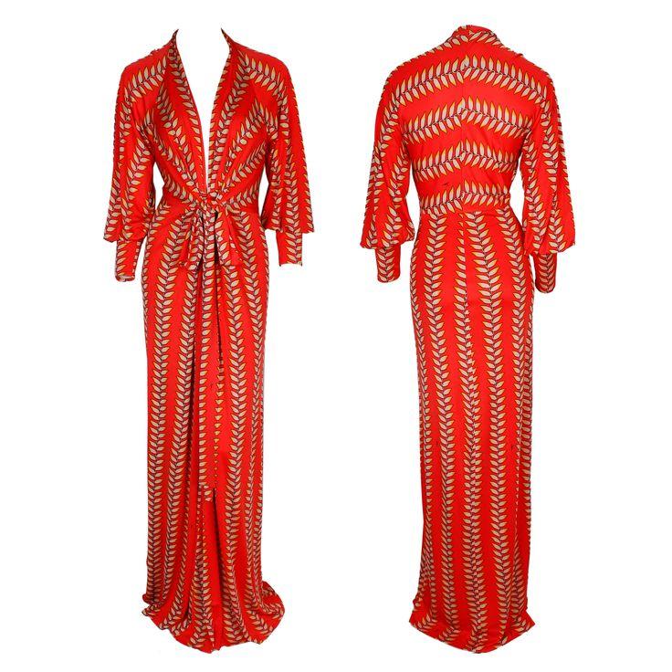 A printed red floor-length dress with cuffed sleeves, a plunging neckline, and gathered with a ribbon at the waistline by Issa London #issa #print #dress #ribbon #luxury #gbmoda #greenbird #hautecouture #fashion #trend #abudhabi #dubaifashion #marinamall #ramadan #elegance