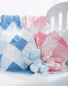 Beautiful double diamond pattern in white with dark and light shades of pink or blue makes a classic gift for that special little one.
