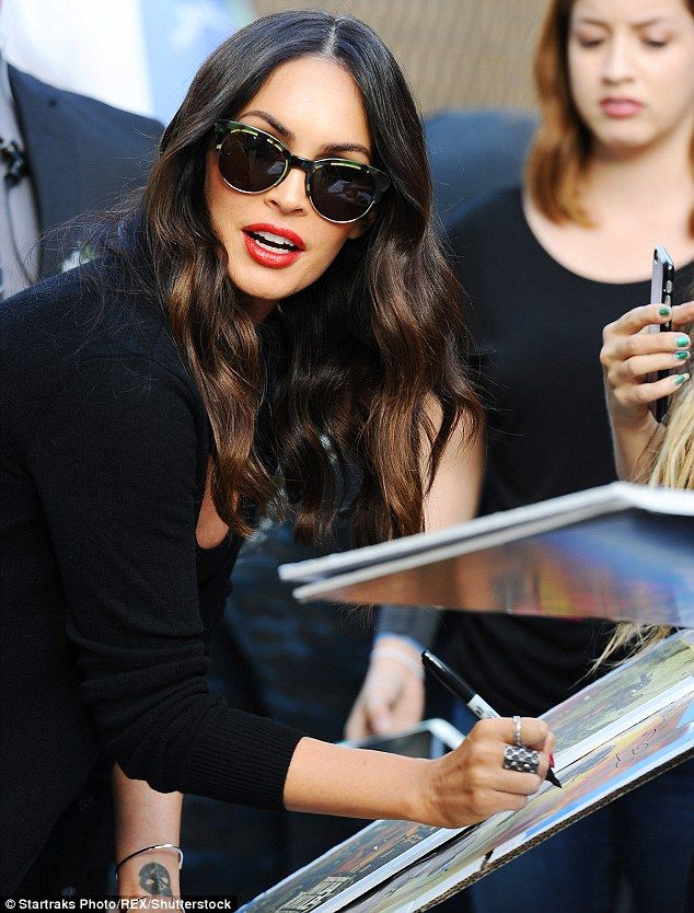 Flawless: The dark haired beauty opted for red lipstick to add a pop of color to her black...