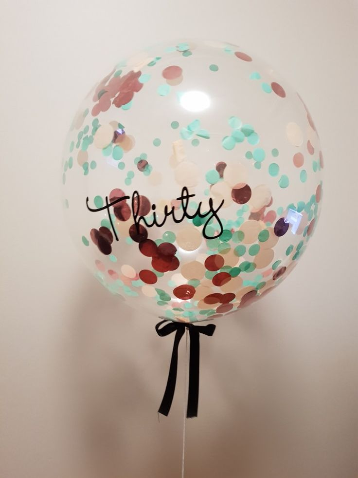 Confetti filled bubble balloon with custom lettering