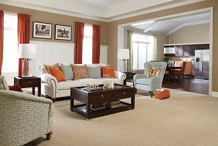 Orange And Teal Living Room Topped Off With Comfortably