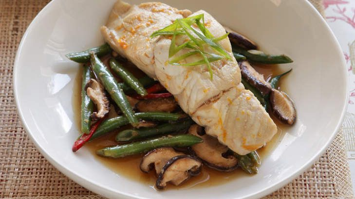 Healthy 'red-cooked' fish with mushrooms and greens.