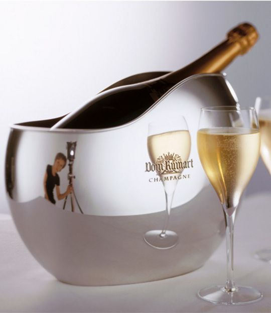 Champagne bowl in shiny solid pewter for Magnum and bottle of  Dom Ruinart Champagne designed by Eris Berthes