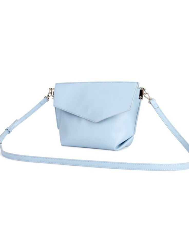Lucy Crossbody Purse - Baby Blue | This adorable little purse features three compartments and a detachable shoulder strap! #torontofashion #CanadianDesigners #canadianfashion #canadianfashionblogger #canadiandesigner #canadianbrands #veganleather #veganfashion #crueltyfree #pixiemood #pixiemoodbag #vegantotes #backpack #veganpurse #purse #convertiblebag #crossbodybag #crossbodypurse #crossbodyshoulderbag #springfashion #torontostyle