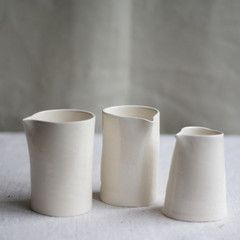 Hand Pitchers. Easy cylinder, pull out a spout, and I'd add a handle.