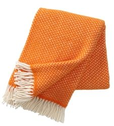 Klippan Polka Orange lambs wool throws at Northlight, perfect for some Spring time colour accents