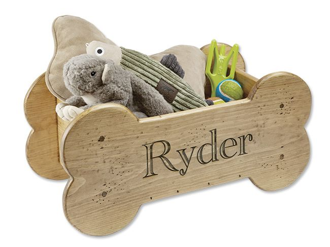 """Keep your dog's favorite toys neatly organized and out of the way in this wood toy bin. That is, until your dog systematically removes each and every one of them. Expertly crafted from solid wood. 11""""H x 24""""W x 12""""D. Personalize with laser engraving, up to 12 letters."""