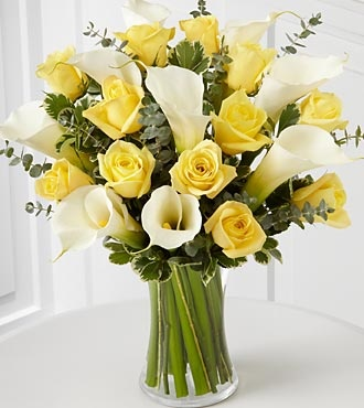 Yellow roses and cala lillies    This would be my ultimate arrangement.  Yellow Roses and White Calla Lillies