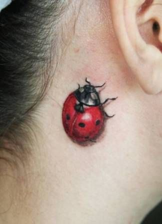 I love these hyper realistic red and black ladybug tattoos. I have seen a million lady bug tats, but this one is my favorite. It's not cartoony. The placement behind the ear is really cute too.-BirdY