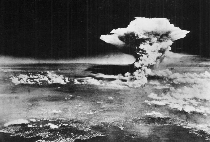 On Monday, August 6, 1945, a mushroom cloud billows into the sky about one hour after an atomic bomb was dropped by American B-29 bomber, the Enola Gay, detonating above Hiroshima, Japan. Nearly 80,000 people are believed to have been killed immediately, with possibly another 60,000 survivors dying of injuries and radiation exposure by 1950.