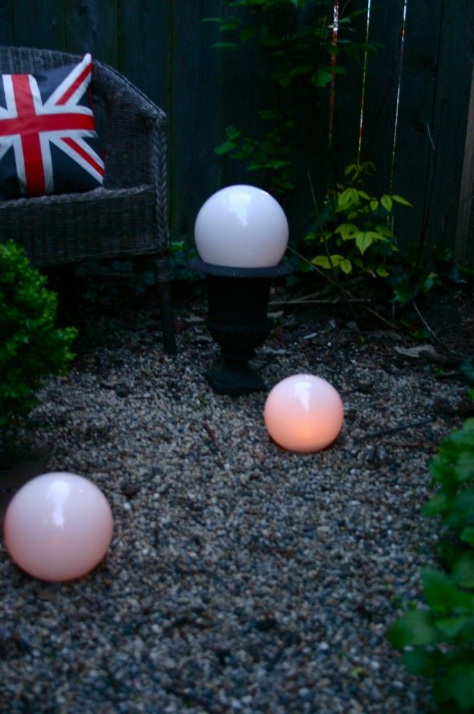 Glass replacement globes – purchased in the lighting section at Home Depot for $4-$7.00 each are lit from within using LED candles.