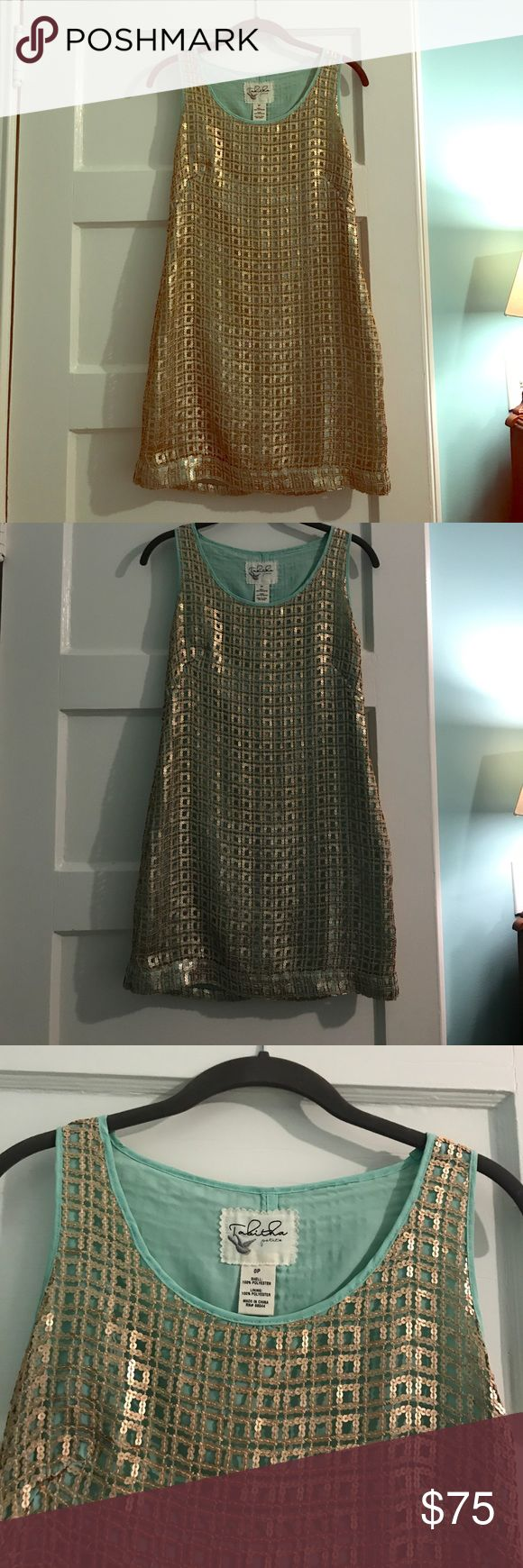 Turquoise and gold anthropology dress Turquoise and gold anthropology dress. GREAT condition and super cute!!!! Gold sequins. Size 0P. Anthropologie Dresses Mini