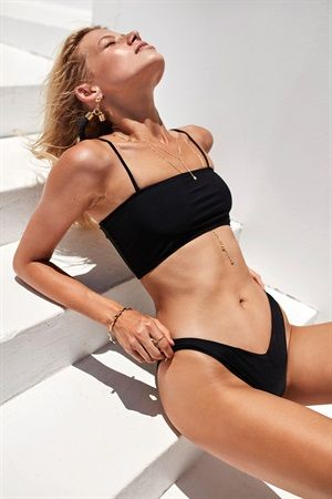 Less is more with the Ray Bandeau Bikini in black! The bandeau style top features thin tube straps and double lining for support and bottoms are double lined feature an asymmetric waistline at front. By Isidora.