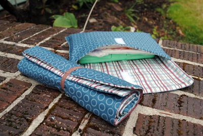 DIY changing pad and diaper/wipes case.  I am so making these for shower gifts.